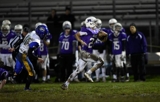 Albany running back Willl Mergen breaks free for his third touchdown of the first quarter against Cathedral Wednesday, Oct. 16, 2019, at Albany High School.