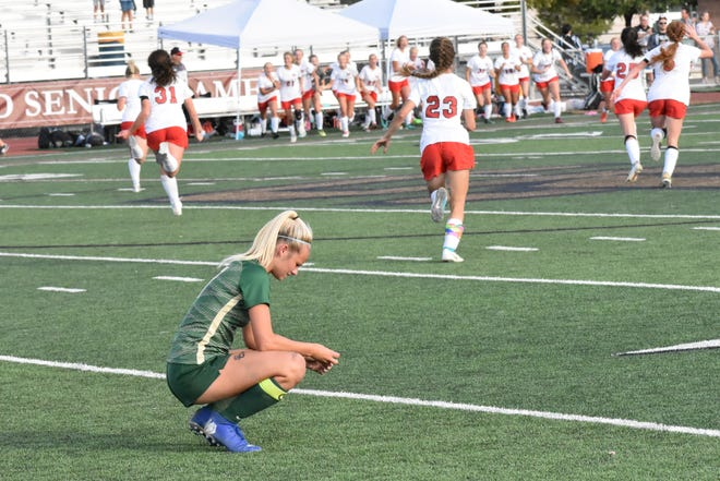 Warriors' striker Heidi Smith crouches in disbelief, while the Utes start celebrating, after No. 14 Uintah upsets No. 3 Snow Canyon Thursday evening.