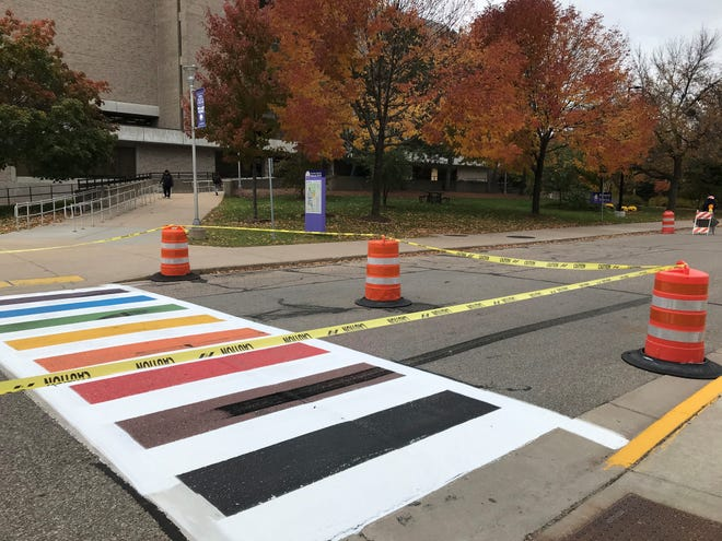 Community leaders and members gathered Monday to paint the Stevens Point's first rainbow Pride crosswalk. It was vandalized on Wednesday.