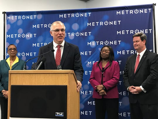 John Cinelli, president of MetroNet, speaks during a Thursday announcement of the company's plans to provide fiber optics to Tallahassee.