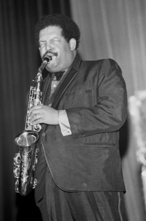 Cannonball Adderley playing the alto saxophone
