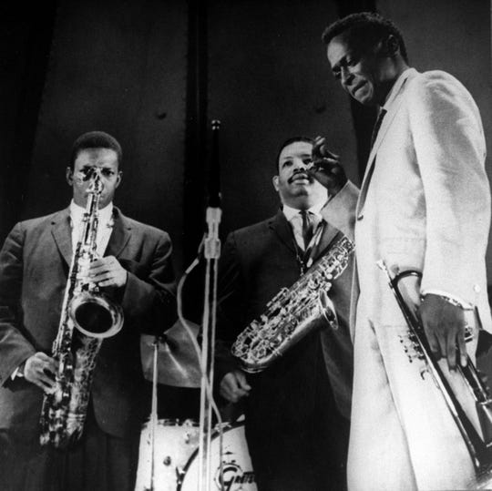 John Coltrane, Cannonball Adderley and Miles Davis performing together.