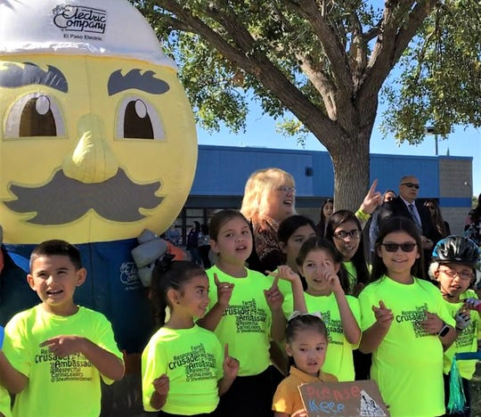 O'Shea Keleher Elementary students with El Paso Electric mascot Ernie G. Watts remind pedestrians to look left-right-left before crossing the street at a pedestrian safety event on Thursday at the school.
