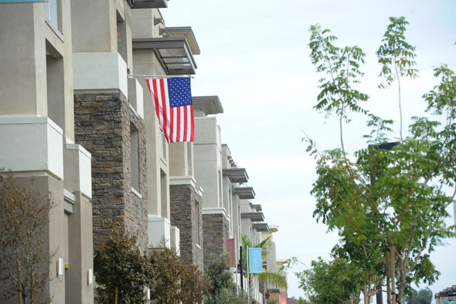 Signs and banners at the Tempo apartments in RiverPark beckon potential renters.