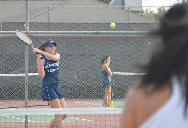 Redwood's Sophie Degn returns a rally against Mt. Whitney on Wednesday in a West Yosemite League girls tennis match.