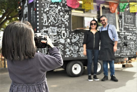 Leah Maldonado, 4, takes a photo of her parent's food truck Que Concha.