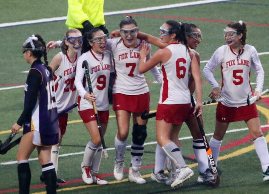 Fox Lane's Natalie Bazyk (7) celebrates with teammates after scoring a first half goal against John Jay during first half action at Fox Lane High School in Bedford Oct. 16 , 2019. John Jay won the game 4-2.
