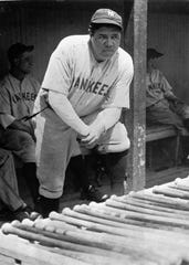 In this July 19, 1929, file photo, Babe Ruth, the Yankees' big bludgeon man, stands in the dugout with a strained muscle in his left leg during a game at Cleveland. The bat used by Babe Ruth to slug his 500th career home run in 1929 is going up for auction, nearly 75 years after he gave it to a friend, Jim Rice, who was mayor of Suffern, New York. Rice's family has kept it ever since. Ruth became the first player to reach the coveted plateau on Aug. 11, 1929, hitting a solo shot for the New York Yankees off Willis Hudlin at League Park in Cleveland.