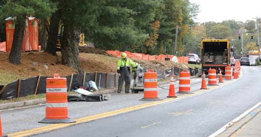 Workers use a saw to cut through the pavement, as work by the New York City Department of Environmental Protection continues along North Broadway in North White Plains, Oct. 17, 2019.