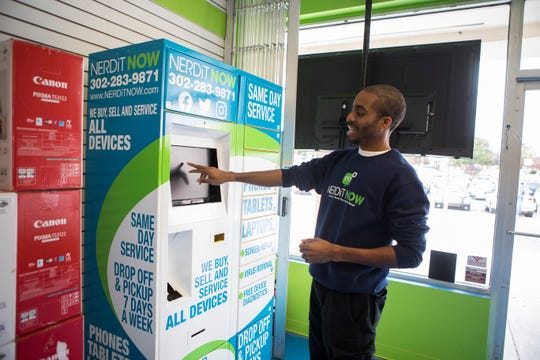 Owner of NERDiT Now tech repair company Markevis Gideon demonstrates how his prototype repair kiosk works at his business in Newport. Gideon recently pitched his kiosk idea on ABC's Shark Tank that will air Oct. 27.