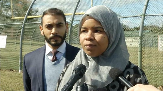 Madinah Brown, a Rehabilitation Counselor at the New Castle County Detention Center speaks to the media about being denied the ability to work while wearing a hijab since July of this year Thursday afternoon.