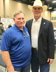 Boys and Girls Club Alumni and Friends President Leroy Chaddick, right, penned a letter of appreciation to Robert London for his 20 years of service as the 82nd Training Wing Volunteer Coordinator.
