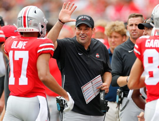 Ohio State coach Ryan Day, center, celebrates with his team after a touchdown against Florida Atlantic in their 2019 season opener.