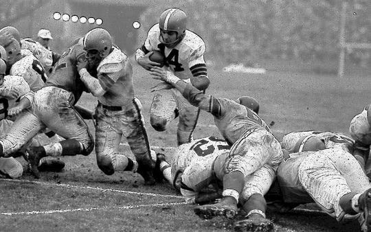 Otto Graham was a three-time NFL champion, a four-time AAFC champion and a three-time NFL (UPI) MVP (1951, 1953, 1955).
