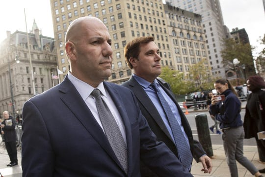 Image shows campaign finance conspiracy suspect David Correia (left) leaving an arraignment hearing in Manhattan federal court in New York City with defense lawyer Jeffrey Marcus on October 17, 2019.