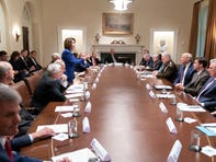 In this photo released by the White House, President Donald Trump, center right, meets with House Speaker Nancy Pelosi, standing left, Congressional leadership and others, Wednesday, Oct. 16, 2019, in the White House.