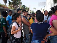 Migrants lined up in Matamoros, Mexico, in August for a meal donated by volunteers from the U.S. at the foot of the Puerta Mexico bridge that crosses to Brownsville, Texas.