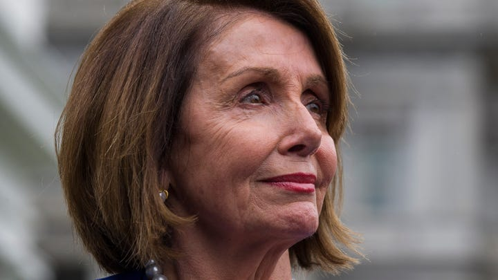 House Speaker Nancy Pelosi listens while speaking with reporters after a meeting with President Donald Trump at the White House.