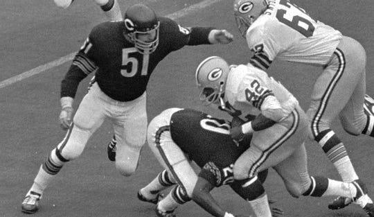 Dick Butkus (51) is a two-time NFL Defensive Player of the Year (1969, 1970), a six-time First Team All-Pro and an eight-time Pro Bowler.