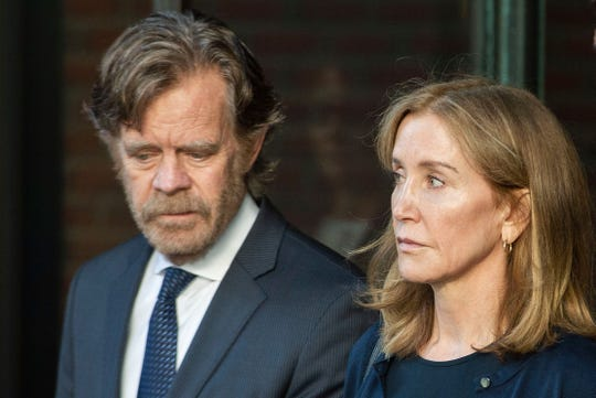 Felicity Huffman and William H. Macy exit the John Joseph Moakley United States Courthouse in Boston, where she was sentenced for her role in the college admissions scandal on Sept. 13, 2019.