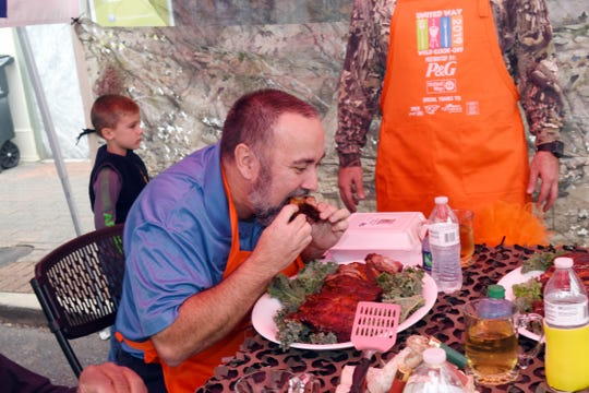 Doug Gann, director of downtown development and special events for Pineville, judges a plate of ribs made by the Rapides Regiona Medical Center team for the 19th annual United Way of Central Louisiana Wild Cook-Off held Thursday. RRMC placed first in the ribs category. The cook-off is a fundraiser for the United Way of Central Louisiana.