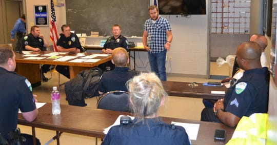 Joseph Buzzetta, executive director of the Central Louisiana Homeless Coalition, meets with Alexandria Police officers during roll-call to explain the new program launching the week of October 21 to educate local panhandlers about the support services available in the area.
