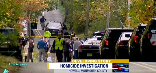 Monmouth County Prosecutors Office and Howell Township police are shown along Hurley Pond Road in the township where a body was found in the roadway Friday morning, October 18, 2019.