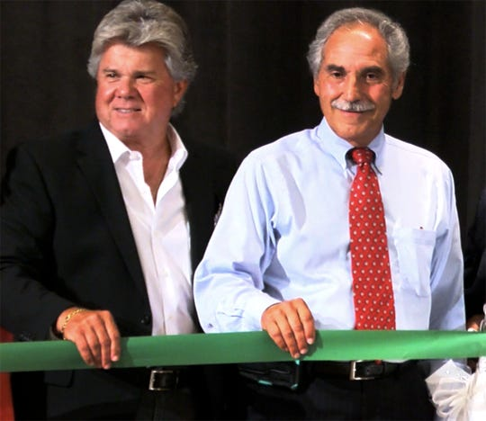 Joseph Ferraina (right), the former Long Branch superintendent, holds the ceremonial ribbon along with George L. Catrambone. a former principal, during the reopening of the old Long Branch High School building Wednesday, September 4, 2019.  Ferraina is a candidate for the Board of Education.