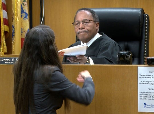 Judge Wendel E. Daniels is handed documents during a hearing for Ciara Williams in State Superior Court in Toms River Friday, October 18, 2019.  She is charged with the murder of her fiancee in Brick Township.