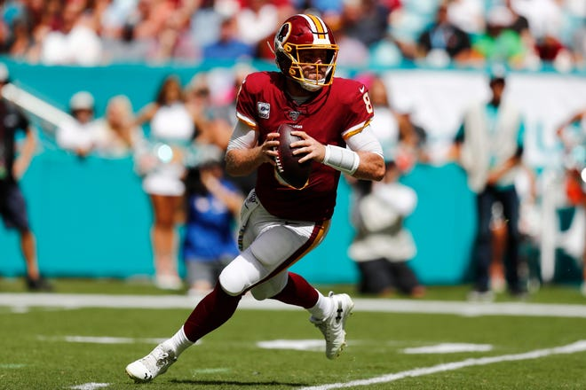 Washington Redskins quarterback Case Keenum (8) looks to pass during the first half against the Miami Dolphins on Sunday, Oct. 13, 2019, in Miami Gardens, Fla. (AP Photo/Brynn Anderson)