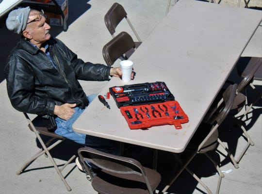 Bruce Mansur relaxes with a cup of iced tea after checking out the tool kit he won at the 50th anniversary celebration of City Lumber last weekend. Oct. 12 2019