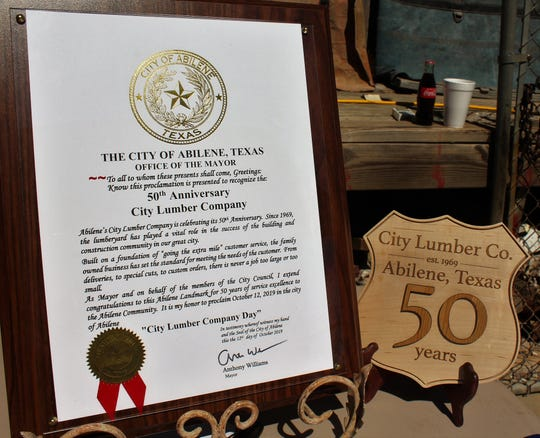 Displayed at City Lumber's 50th anniversary celebration were a proclamation from the city of Abilene and a homemade road sign.