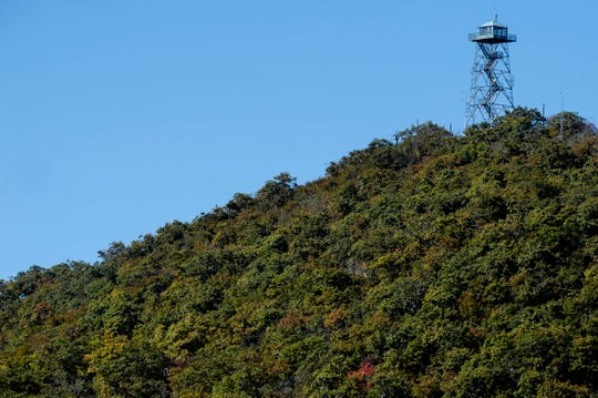 The Fryingpan Mountain lookout tower is seen from the Blue Ridge Parkway October 17, 2019.