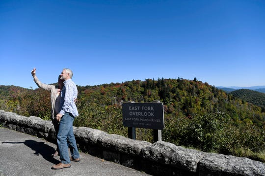 People pose for photos along the Blue Ridge Parkway October 17, 2019.