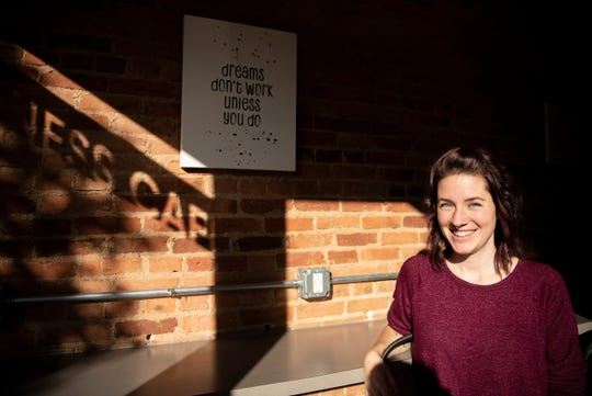Lakota Fradette, owner of the vegan food company the Hangry Herbivore, poses for a portrait on Friday, Oct. 18, 2019 at Outside the Box Functional Medicine and Wellness Café in Marshall, Michigan. After almost a decade of working as a stay at home mom, Fradette is running her own business to share recipes with the community that helped her lower her cholesterol.