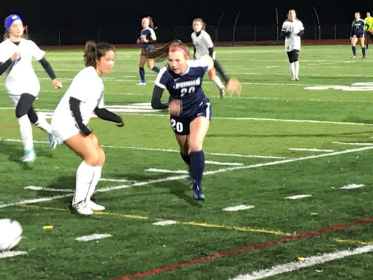 Chenango Forks' Emma Bough pursues the ball during Thursday's Southern Tier Athletic Conference final against visiting Maine-Endwell. The teams played to a 0-0 tie.