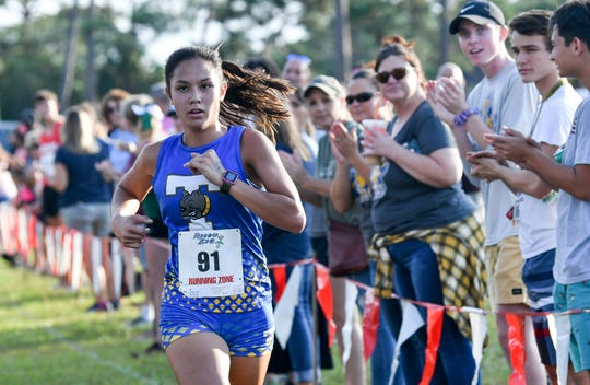 Runners from area cross country teams race for top honors at the Cape Coast Conference meet Thursday in Wickham Park. Billie Castillo of Titusville is the girls individual champion.