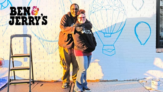 Two artists planning to paint a mural outside of Burlington's downtown Ben & Jerry's shop pose in an undated photograph.