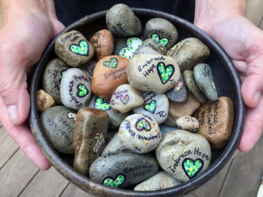"""""""Embrace Hope"""" hides stones painted with the words in parks and other public places to be discovered by someone who may be dealing with addiction."""