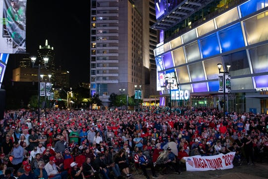 President Trump supporters watch his speech on a screen outside the American Airlines Center in Dallas, Texas after it was filled to capacity during his campaign rally on Thursday, Oct. 17, 2019.