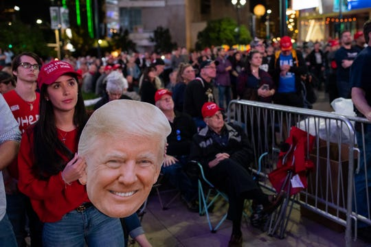 President Trump supporters watch the Presidents speech on a screen outside the American Airlines Center in Dallas, Texas after it was filled to capacity during a campaign rally on Thursday, Oct. 17, 2019.