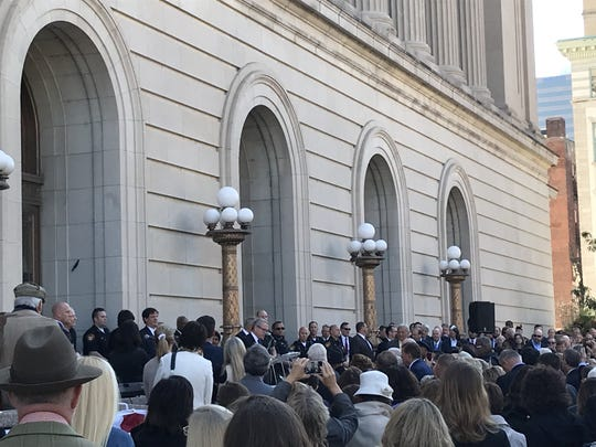 Ohio Gov. Mike DeWine addresses hundreds of people Friday, Oct. 18, 2019,  at the 100th anniversary celebration of the dedication of the Hamilton County Courthouse.