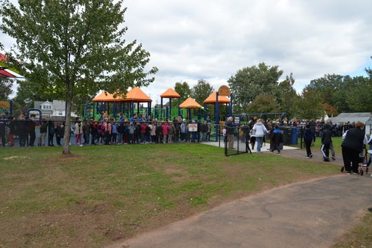 Students filled the playground at the newly opened Matthew Jago School in the Sewaren section of Woodbridge on Friday.