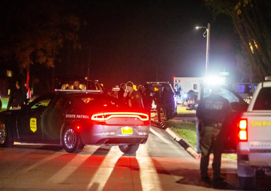 Authorities investigate the scene after multiple law enforcement officers were shot in Stuart Friday, Oct. 18, 2019.