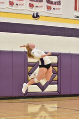 Norwalk's Maddy Zimmerman serves in a game against Dallas Center-Grimes on Tuesday, Oct. 15. The Fillies won the match in four sets (27-29, 25-21, 25-17, 25-14).
