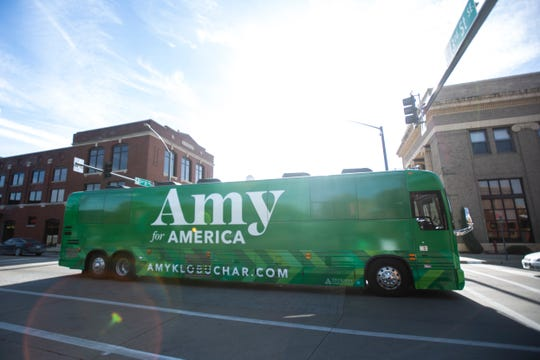 The bus for Democratic presidential candidate U.S. Sen. Amy Klobuchar, D-Minn., heads to its next stop after the kickoff event at her 'For All of America' bus tour, Friday, Oct., 18, 2019, outside the NewBo City Market in Cedar, Rapids, Iowa.