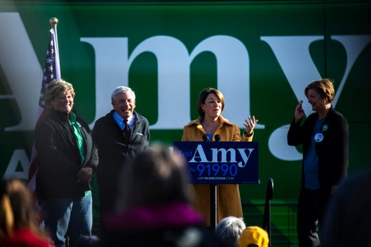 Democratic presidential candidate U.S. Sen. Amy Klobuchar, D-Minn., speaks during the kickoff event at her 'For All of America' bus tour with Iowa Sen. Liz Mathis, right, along with Reps. Andy McKean and Molly Donahue, Friday, Oct., 18, 2019, outside the NewBo City Market in Cedar, Rapids, Iowa.