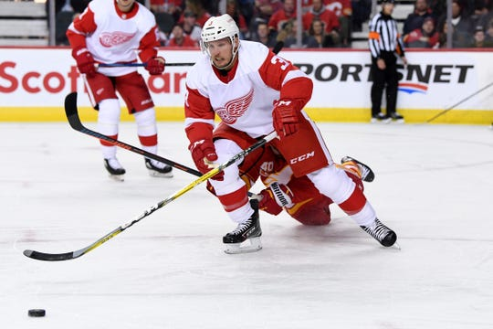 Detroit Red Wings defenseman Alex Biega (3) chases after the puck in the first period against the Calgary Flames at Scotiabank Saddledome on Oct. 17, 2019 in Calgary.