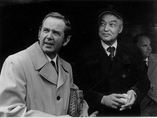Governor William Milliken and Detroit Mayor Coleman Young in the dugout at Tiger Stadium in Detroit.  One will throw out the ceremonial first pitch and the other one will catch it.  Detroit Free Press photo by Tony Spina, chief photographer April 9, 1974