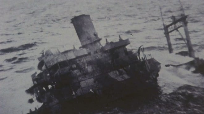 """The USS Pollux, shipwrecked on the rocks of Lawn Point, Newfoundland, in February 1942. The documentary film """"As If They Were Angels"""" depicts tragedy and heroism involving U.S. sailors and the people of two small coastal towns who came to their rescue."""